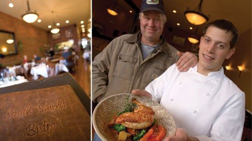 Farmer Doug Raubenolt with Chef Michael Mariola of South Market Bistro in Wooster. Farmer-chef collaborations are becoming increasingly popular. Mariola is holding a Tea Hills-grown pan seared chicken breast, served over slow roasted summer vegetables.