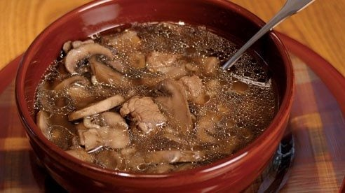 To enhance the mushroom flavor of this soup, sauté the mushrooms in a small amount of butter before adding to the meat mixture.