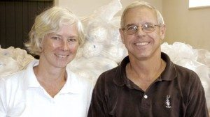 Betsy and Dudley Humphrey Jr. stand in front of hundreds of popcorn balls awaiting shipment.