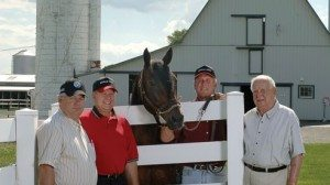 "From left, Robert Schwartz, John Mossbarger, Jay Mossbarger and Don ""Doc"" Mossbarger have been raising Standardbred horses since the late 1960s."