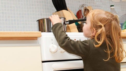 Keep kids and pets 3 feet away from the stove. And use the back burners when you can to keep pans from getting knocked off by children. If you use the front burners, keep the handles turned inward.