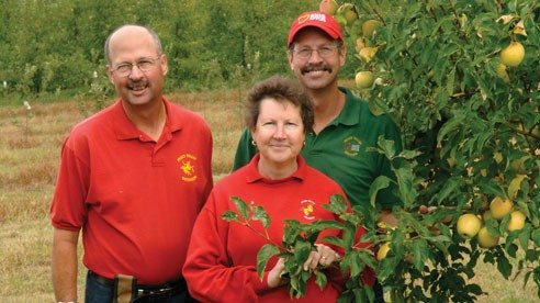 How many siblings have to sit down each year to decide whether they should get a raise or, for that matter, take a pay cut? Paul Simmons, left, his younger brother Dan and their sister Carol have worked together at Peace Valley Orchards since childhood.
