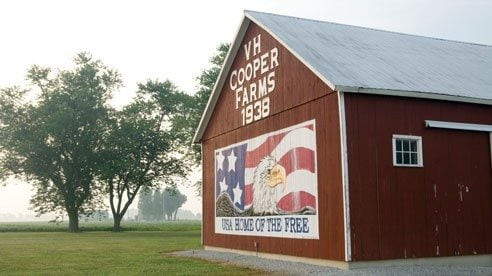 The Cooper family's barn, a classic symbol of Americana, emerges from the early morning mist.