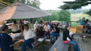 Patrons enjoy the early evening atmosphere outside the tasting room.