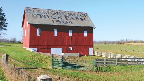 The Mitchell's renovated bank barn was originally built in 1904. Decorative arched louvers are used for ventilation.