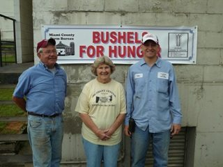 Carlos Wolfe - Miami County Farmer, Vounteer from Bethany Center, Tom Treon - Troy Elevator