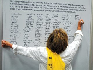 Ohioans signed their names to express opposition to House climate legislation during a rally in Lima last month.