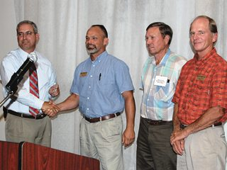 From left, OFBF's Mike Bumgarner with Farm Credit Services directors Andrew Wilson, Roger Earley and George Stebbins