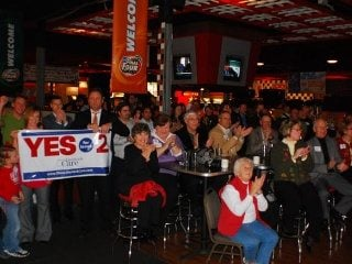 Supporters celebrate Issue 2's passage Tuesday evening