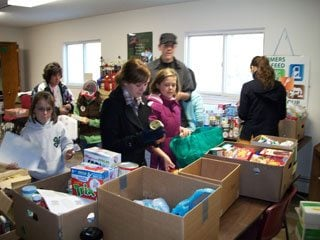 FB Youth Group sorts food collected for local food pantry