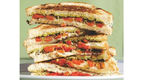 Include pesto and red peppers to make the perfect grilled cheese sandwich.