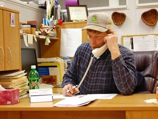Ross County Farm Bureau volunteer, John Fuller, makes membership phone calls.