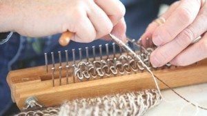 Fiber is weaved on a loom.