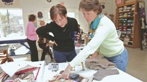 Karen Burke (left) and LeeAnn King go over designs.