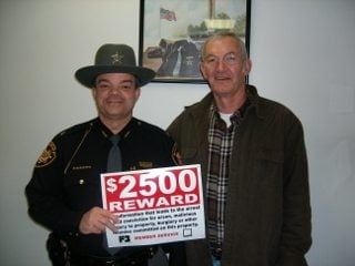 Ross County Sheriff George Lavender with Ross County Farm Bureau member Frank Clary.