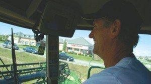 Over the past two decades, Neall Weber (next) and his father, Steve, (above) have watched suburbia creep closer to their farmland in suburban Columbus. They try to run their equipment during hours that are more agreeable to their suburban neighbors.