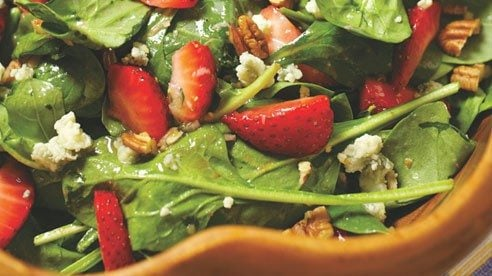 "If spring has a flavor, it would be that of tender, young spinach leaves...so fresh and ""green"" and willing to share the spot-light with sweet, local strawberries."