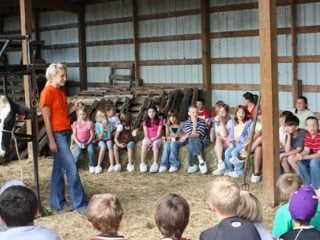 Alyssa Holter talks with third-grade students from Southern Elementary in Racine about Holstein cows & how to milk them.