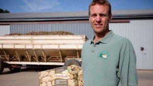 Todd Michael holds a sack of spuds grown at Michael Farms and packaged under the Heartland label.