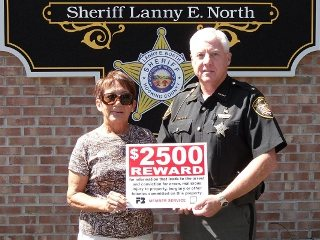 Hocking County Farm Bureau volunteer Jo Ann Murtha stands with Hocking County Sheriff Lanny North.