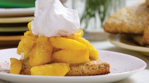 These delightful rustic shortcakes have a great texture — tender, crumbly and slightly crunchy — a fitting companion and compliment to sweet, juicy peaches.