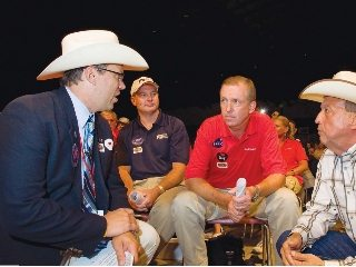 Mike Townsley (in red), of Bob Evans is seated next to OFBF's Steve Hirsch at the 2010 Sale of Champions.