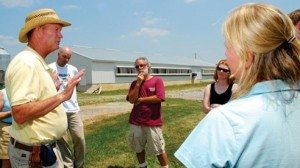 Randy Brown explains the farm's history to visitors. His son Kyle represents the fifth generation on the farm.