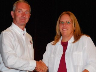 Jenifer Weaver is congratulated by Ohio Farm Burea President Brent Porteus upon receiving her award.