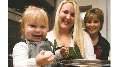 Debbie Miller, shown here with her daughter, Stacy Webb, and granddaughter, Madeline, believes home cooking can be a family affair.