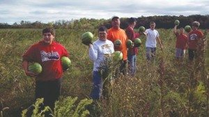 Several members of the 8th grade football team at Archbold schools helped glean watermelons from a farm field so they could be donated to a Toledo food bank.