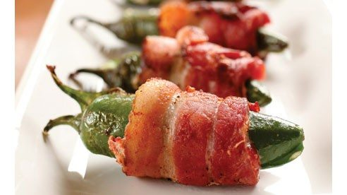 Anything wrapped in sweet, smoky bacon is a sure crowd pleaser especially these kicky peppers filled with warm, creamed cheese. Try another fun variation by stuffing a large, dried date with a smoked almond, wrapping with a slice of bacon then grilling until the bacon is crispy. Outstanding!