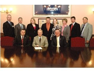 Ohio Farm Bureau members join Gov. Ted Strickland and state officials following the passage of HB 414.