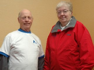 Brown County's Jim Crocker (left) and Morrow County's Eddie Lou Meimer model Farm Bureau membership award apparel.