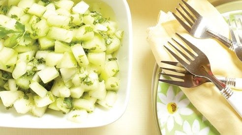 Cool off at the end of a hot summer day with this refreshing salad. Chill the melon cubes for just about an hour so they are refreshing yet the taste still comes through.