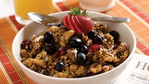Rolled oats and Grapenuts cereal add whole grain goodness to this cranberry, coconut, and walnut granola.
