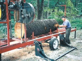 Orville Crocker sawing a large cherry log harvested from the farm in 1996.