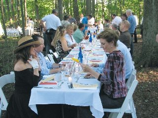 Farmers gathered with other community members to share a meal and raise money for a local humane organization.