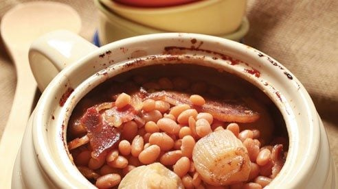 Long and slow cooking, this earthy and aromatic bean recipe starts with dried beans (the best choices are pea, navy or white beans, or a mixture of all three) and gets big boosts of flavor from smoked bacon, sweet cider, molasses and spicy dried mustard.