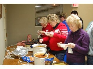 Members testing all of the chili!