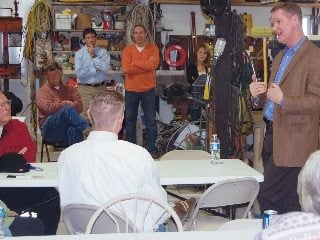 Rep. Steve Stivers addresses farmers and ag leaders during a visit to the farm of Farm Bureau member Norman Dresbach.