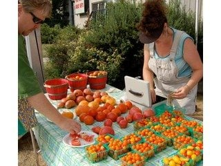 Farmers interact with customers at Clintonville Farmers' Market