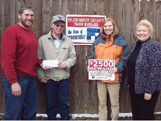 (L to R) Muskingum Co. Farm Bureau President James McDonald, James Secrest, and OFBF's Kari Burkey and Danielle DuFour