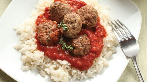 Based on fresh lamb sausage mixture called 'merguez' that is popular in Europe and North Africa, these meatballs feature the warm kick of harissa, an easy seasoning to find in herb and spice shops. It's worth adding and specific, but as a substitution, add a little extra cayenne pepper to taste.