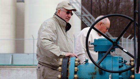 Keith Burgett (L) and Carroll County Farm Bureau President John Davis discuss a large drilling project on Burgett's farm.