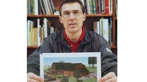 Todd Davis holds up a rendering of a new building planned for Ohio FFA Camp Muskingum.