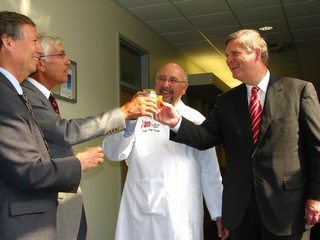 CAFFRE staff and business partners tasting tomato soy juice with Secretary Vilsack