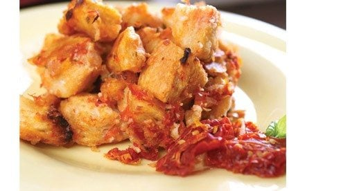 This savory take on classic bread pudding will only be as good as the tomatoes that go into it so be sure the tomatoes are at their peak of flavor and ripeness. For an added burst of flavor, add two tablespoons of chopped sun dried tomatoes.
