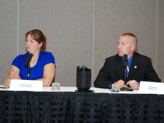 Clemson, left, and Heimerl, right, competing in the Discussion Meet semi-finals at OFBF's Leadership Conference.