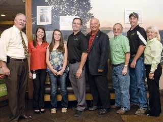 Lea Kimley (third from left) was recognized for exhibiting the Grand Champion Barrow at the Ohio State Fair.