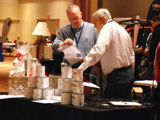 Members checking on their bids at the live auction held during annual meeting.